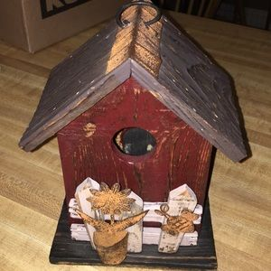 Decorative birdhouse with flower/bee fence used